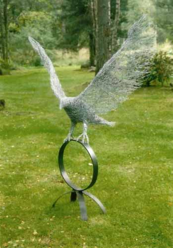 8. Wire eagle landing on a steel base