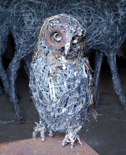 14. Wire owl in the studio, wire and recycled materials