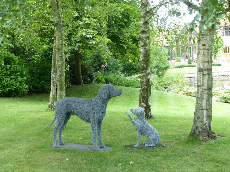 17. Best friends wire dog sculptures