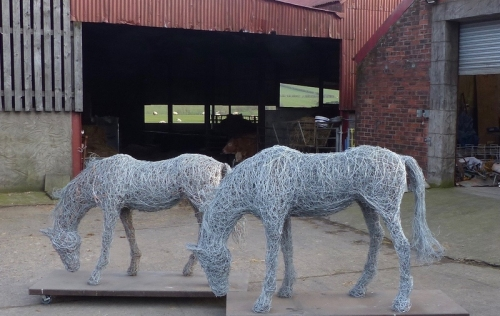 89. Grazing Together, 2 grazing horses , steel wire and copper wire sculptures, free standing.