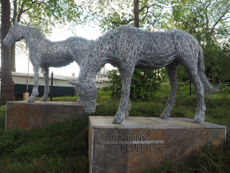 45. Wire horses on a slate base
