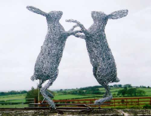 28.  Wire boxing hares against the sky detail, 2004