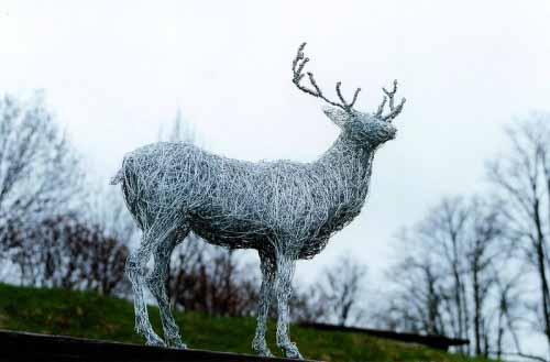 4. Miniature wire stag against the sky