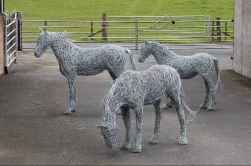 2. Three wire horse sculptures on the farm getting ready for Chelsea Flower Show.