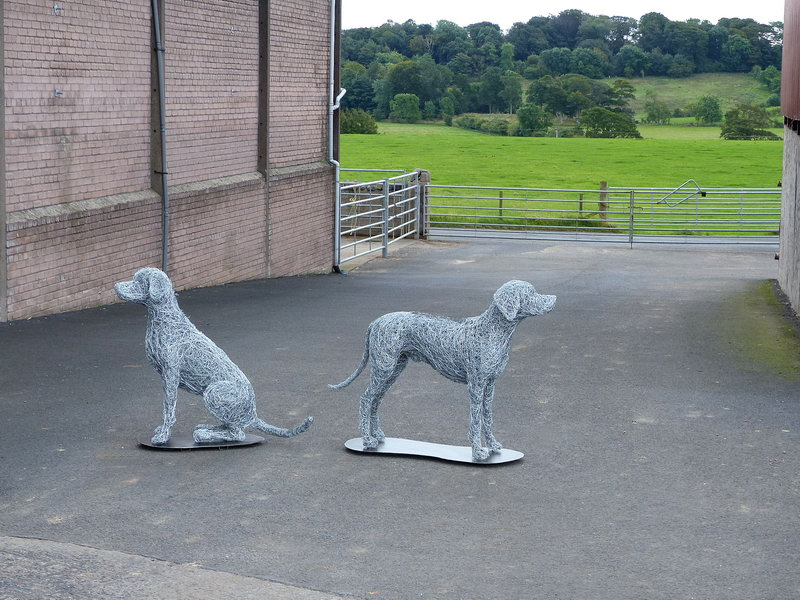 1. Finishing touches, large wire dogs on a steel base