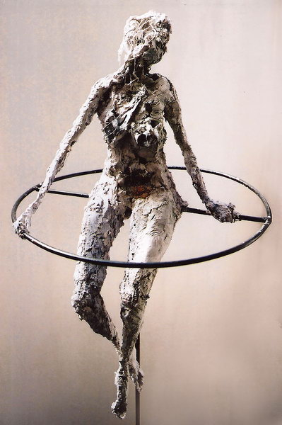 6. Figure on a wheel (plaster, steel and recycled materials)