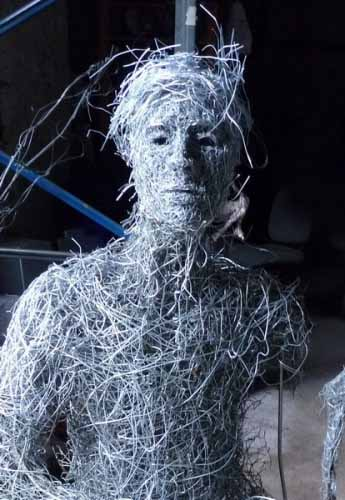 1. Close-up of seated wire figure sculpture