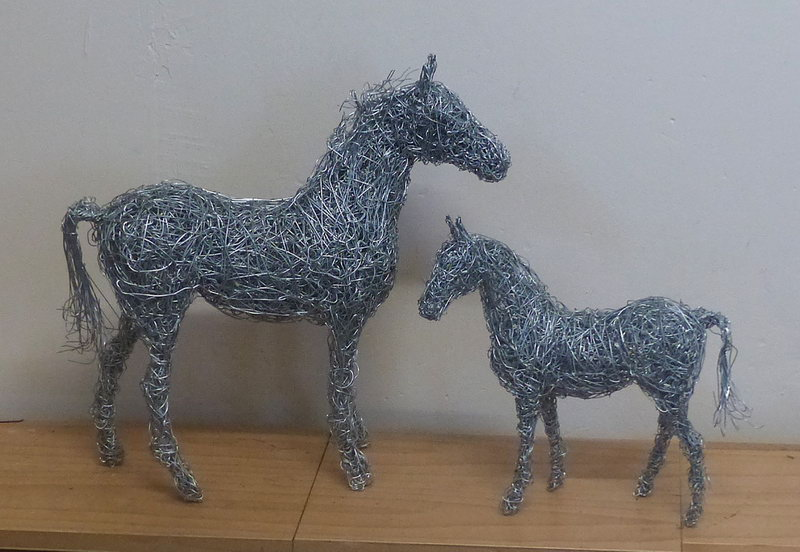 8. Two miniature wire horses