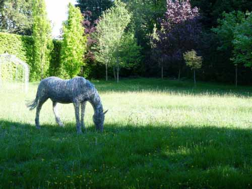1.  This life-size wire grazing horse was later joined by a wire foal made to commission.