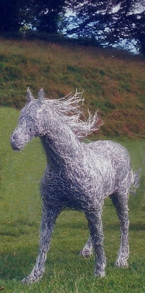 35.  Wire horse sculpture In motion on a windy day at Drumlanrig Castle, Dumfriesshire