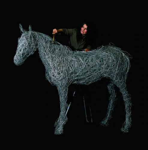 Laura Antebi building a life-size wire horse sculpture in the studio