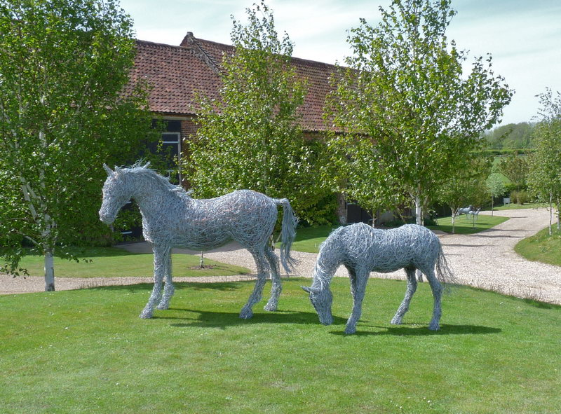 18. Wire mare and foal in copper and steel on the lawn just arrived at their beautiful new home