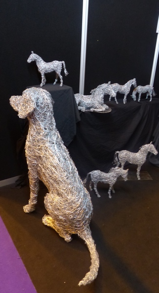 12. Wire dog sitting with wire horse miniatures
