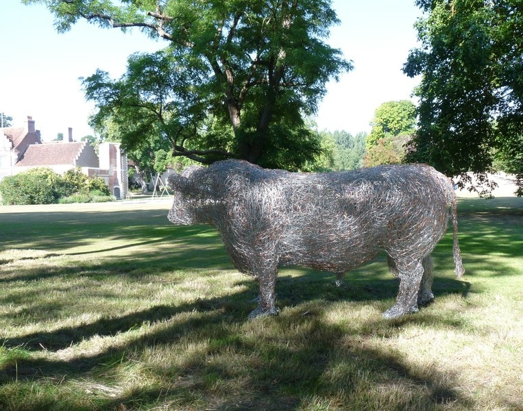 9. Bull wire sculpture in dappled light