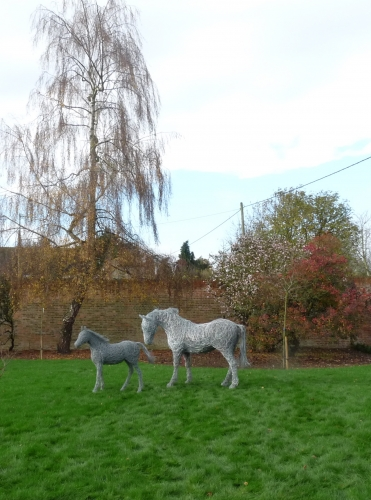 54. Mare and foal sculptures in galvanised steel wire