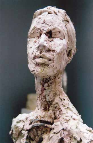 8. Portrait of a woman (plaster,steel and recycled materials)