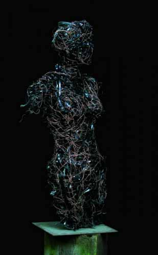 7.  Woman with black ties (reclaimed plastic and steel)
