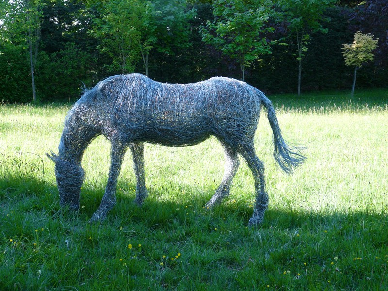 89. Wire grazing horse sculpture in the morning light.