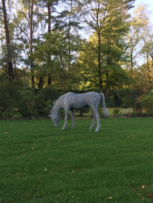 61. Grazing horse sculpture on the lawn.