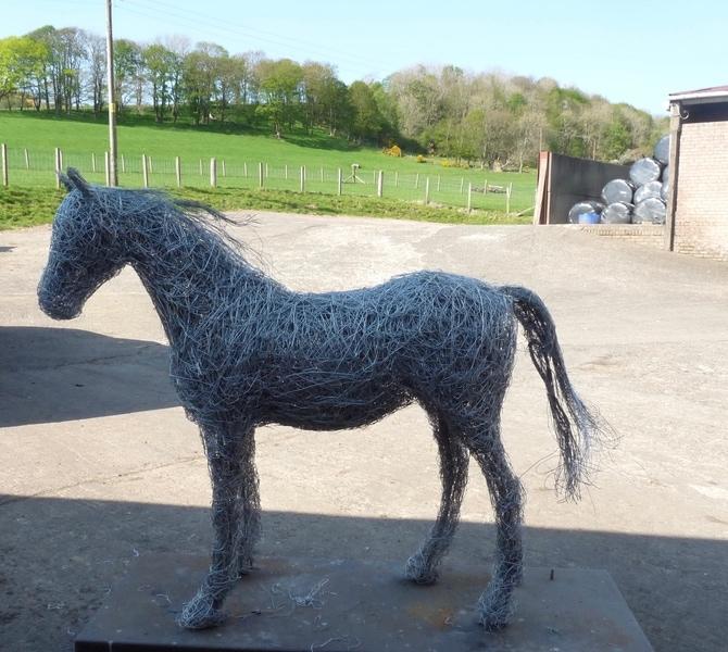88. Silhouette, wire horse sculpture.