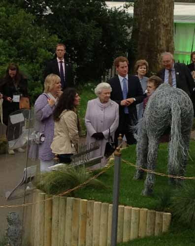 The Queen inspecting a wire horse