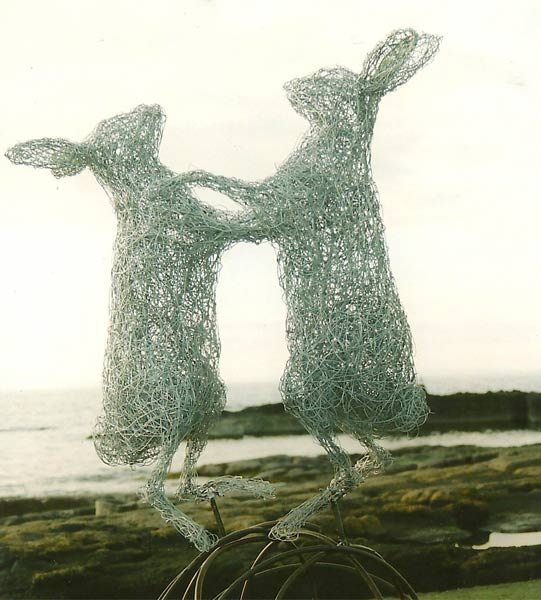 31. Boxing hares sculpture by the ocean