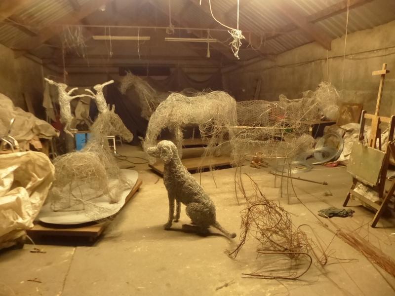 9.  Sitting dog wire sculpture.