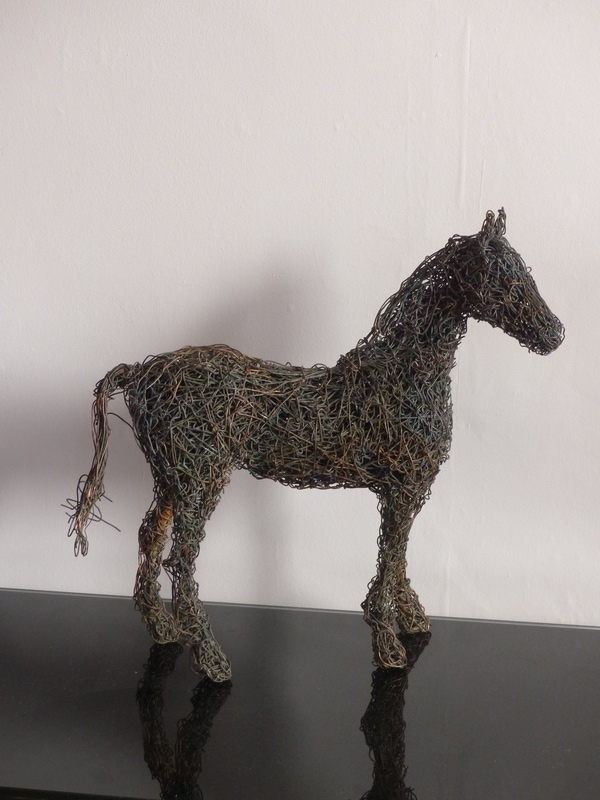 2. Colt. Copper wire horse sculpture available.