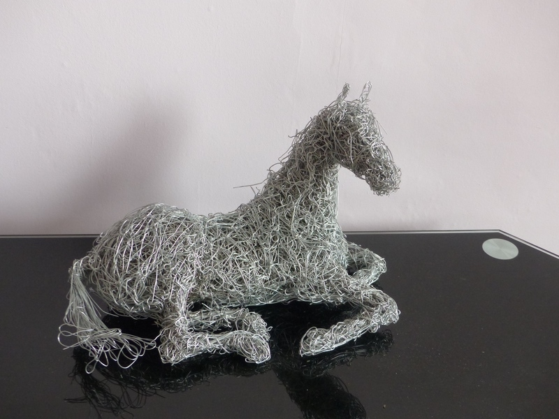 12. Horse sculpture for the mantelpiece available.