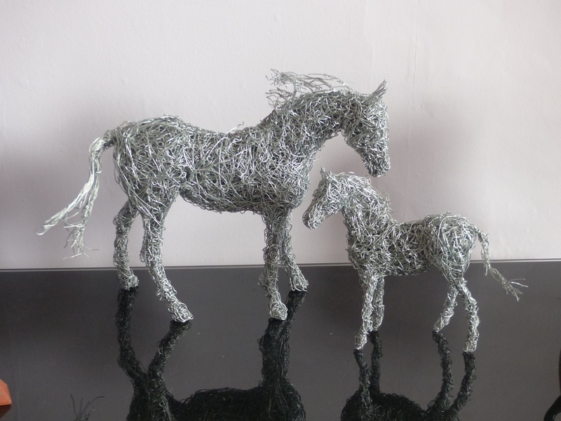 4. Wire mare and foal sculptures available.