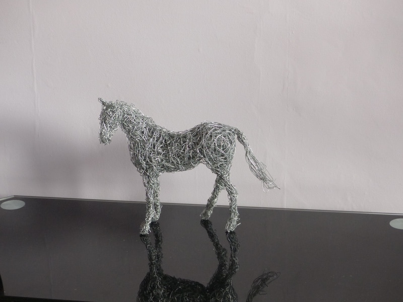 10. Horse miniature available.