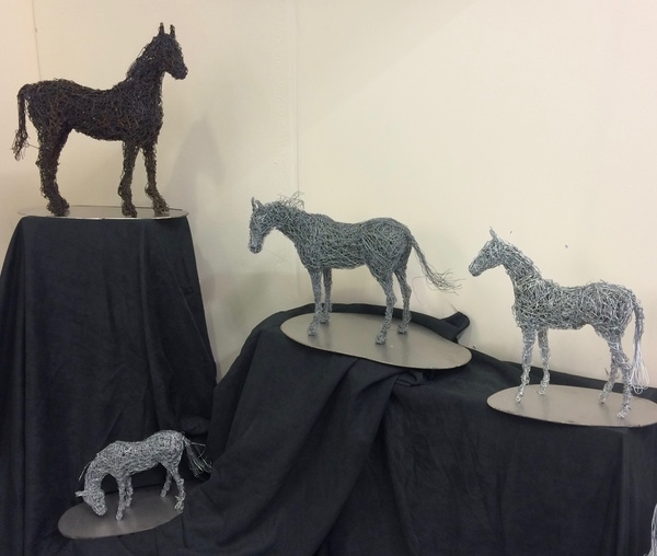 24. Four small horse sculptures on display at Olympia Horse Show 2017