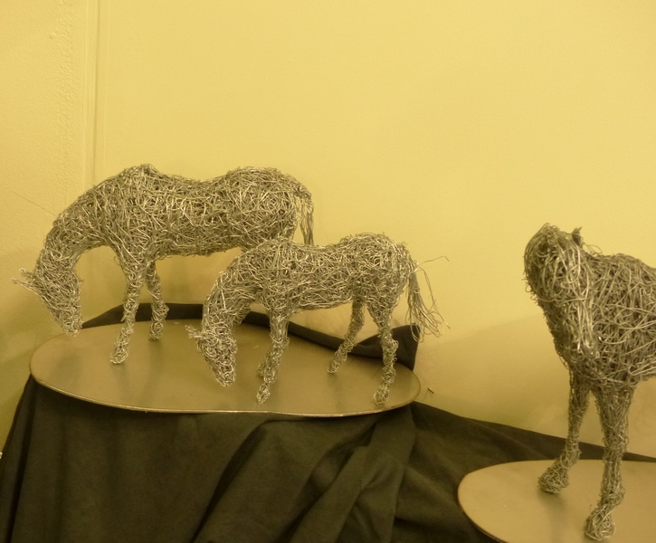5. Miniature grazing horse sculptures available.