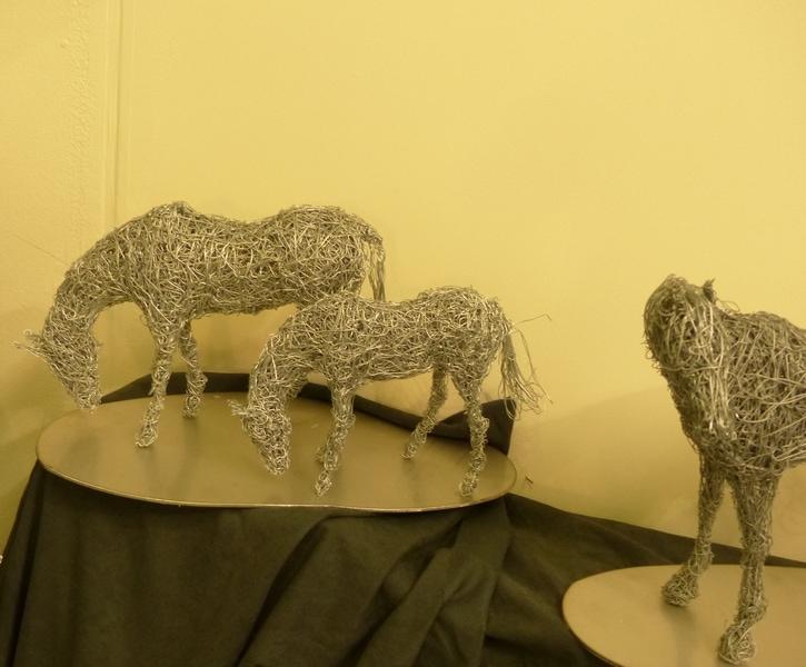 5. Miniature grazing horse sculptures available.